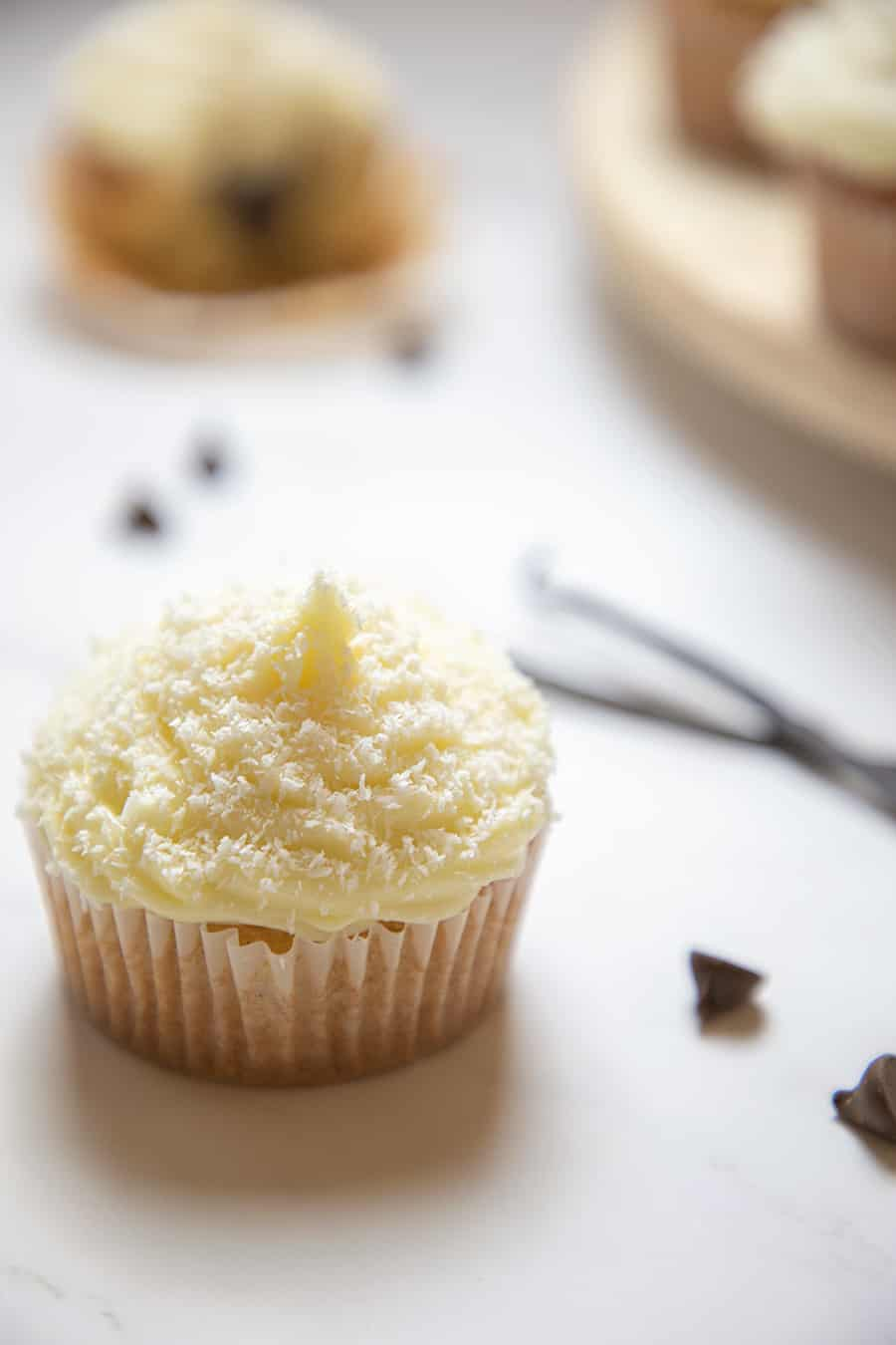 These gluten-free coconut cupcakes are filled with chocolate ganache and topped with cream cheese frosting. The flavor of the coconut is highlighted by the chocolate and cream cheese frosting.