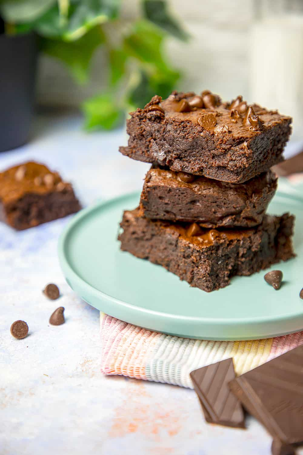 gluten free fudge brownies photo. The brownies are stacked on top of each other.
