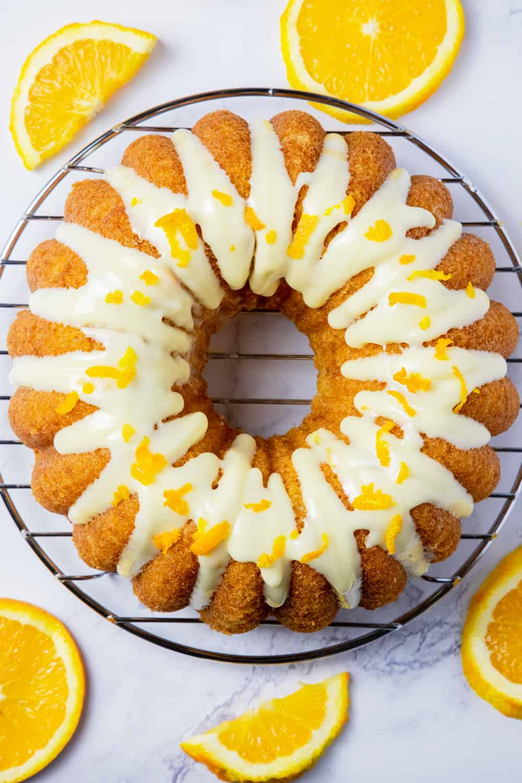 gluten free orange bundt cake with orange cream cheese frosting.