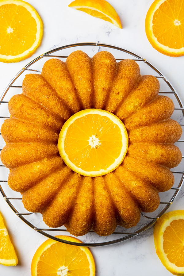 orange bundt cake decorated with fresh oranges