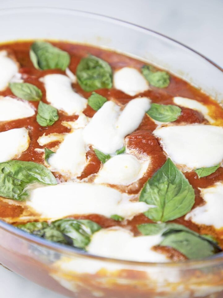 gluten free meatballs covered with tomato sauce, cheese, basil