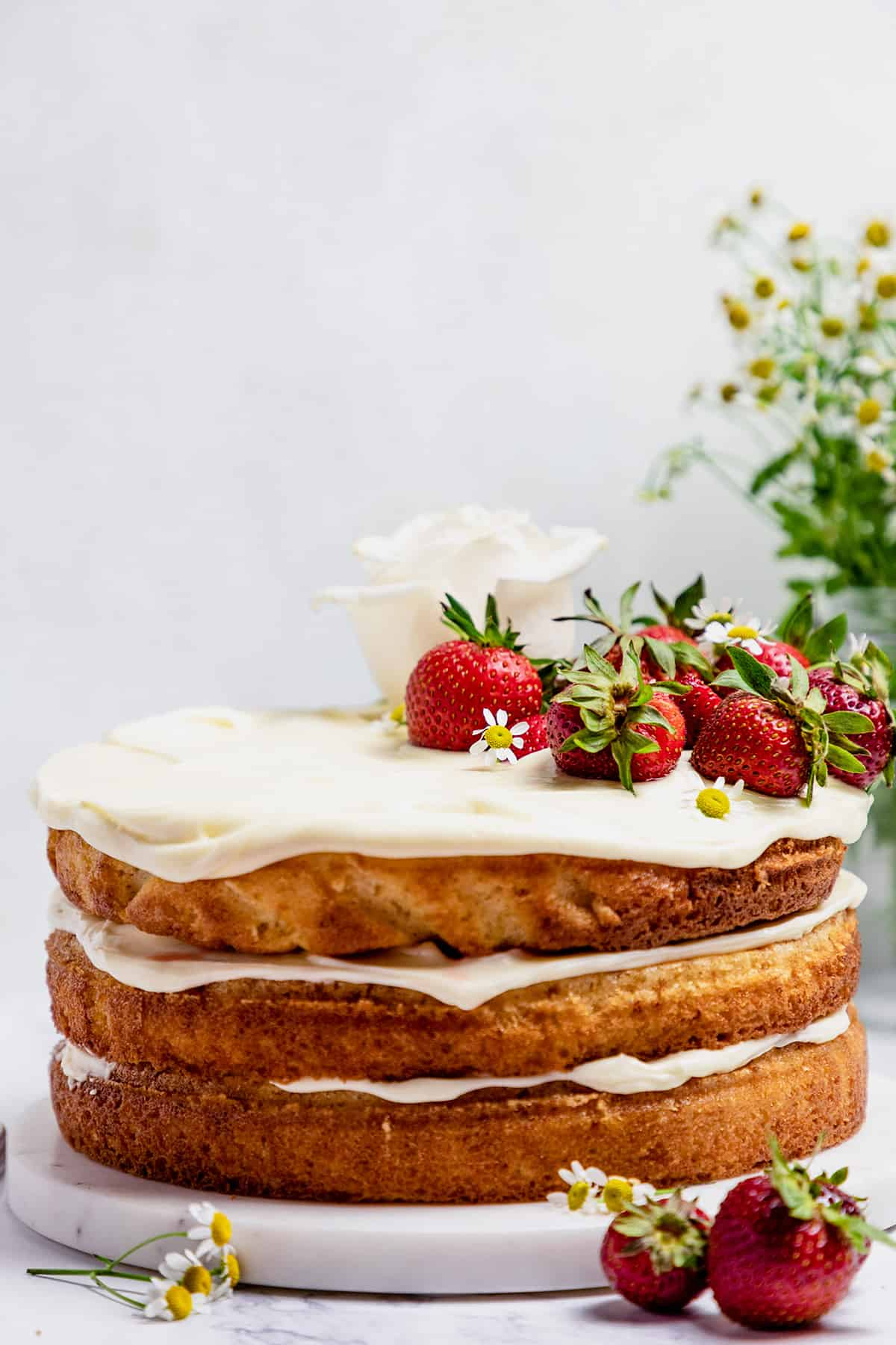 strawberry jam cake on a marble board