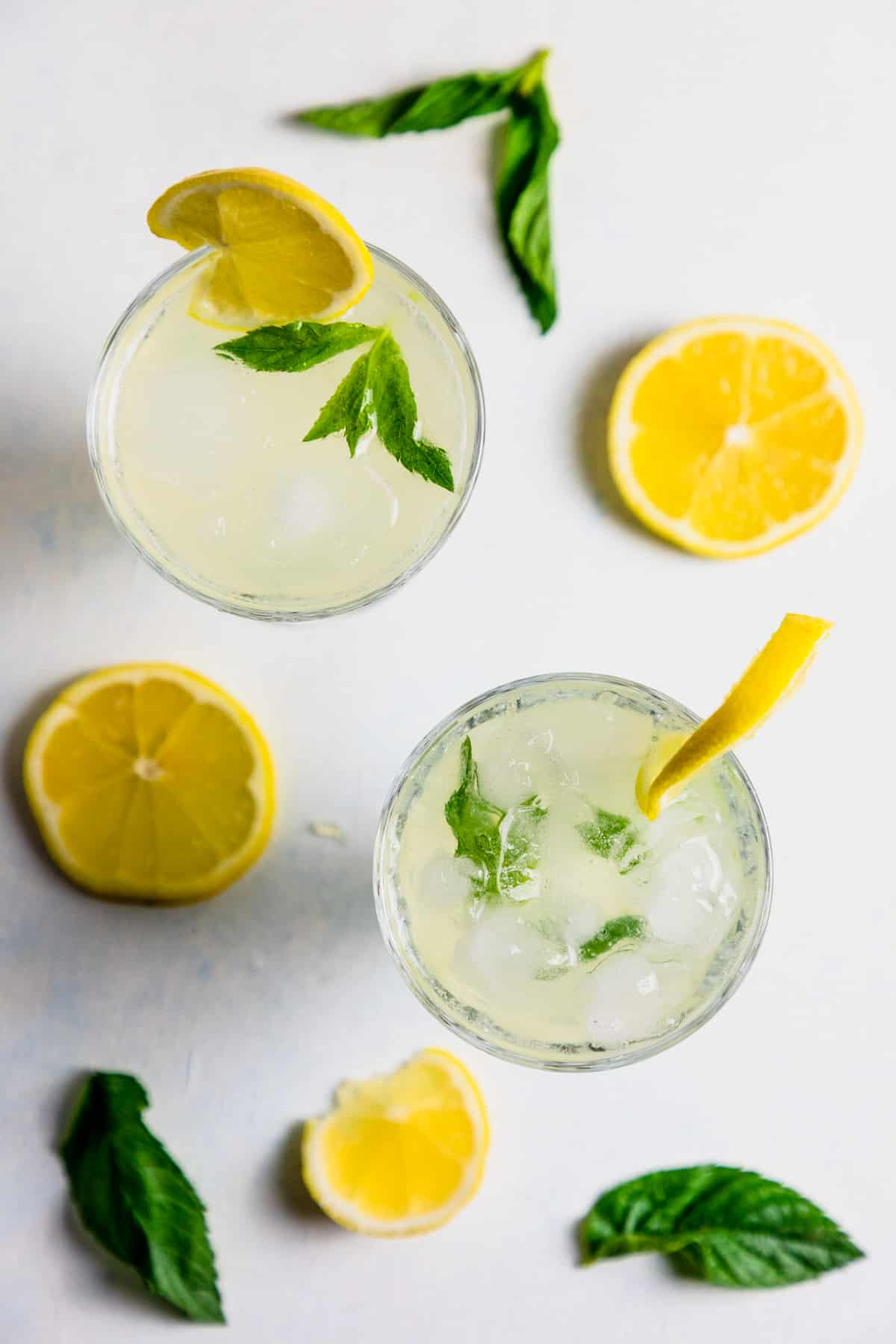 top view of two cups filled with homemade lemonade with mint.
