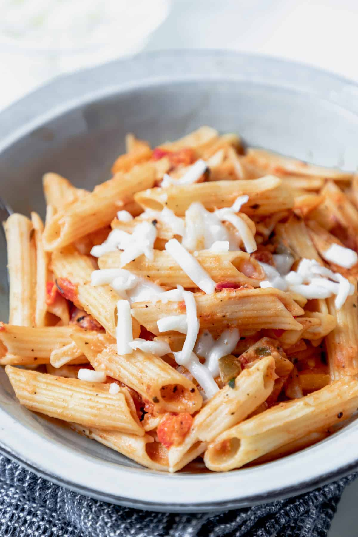 Gluten-free pink sauce pasta made with coconut milk. This pink pasta recipe is healthy and can be made vegan. The pasta is easy to make and is an ideal dinner recipe for a busy workday.