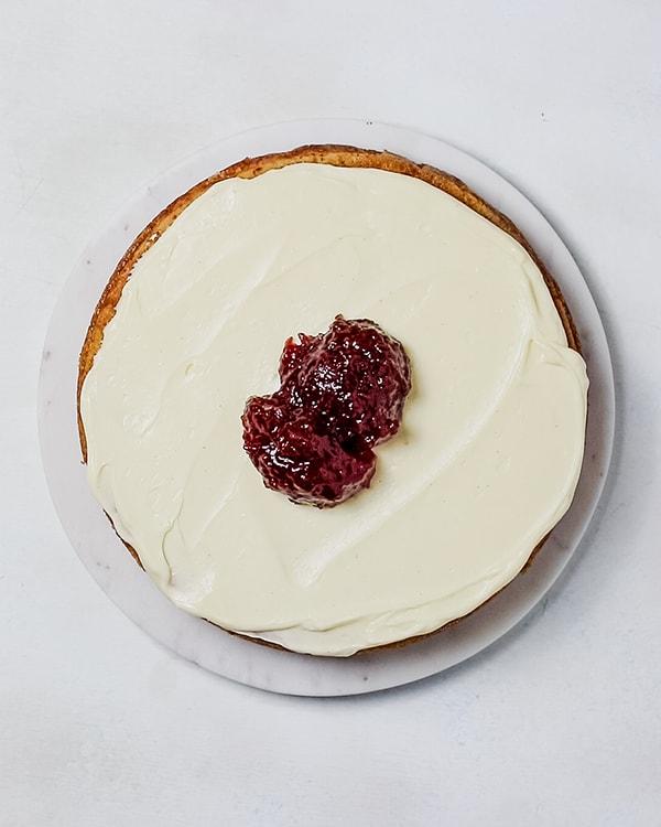adding the strawberry jam to the cream cheese