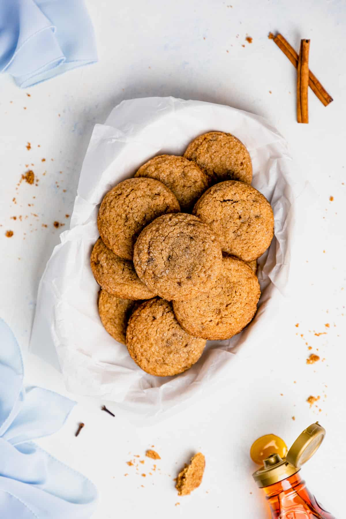 gluten free ginger snaps on a plate surrounded by a blue kitchen towel.