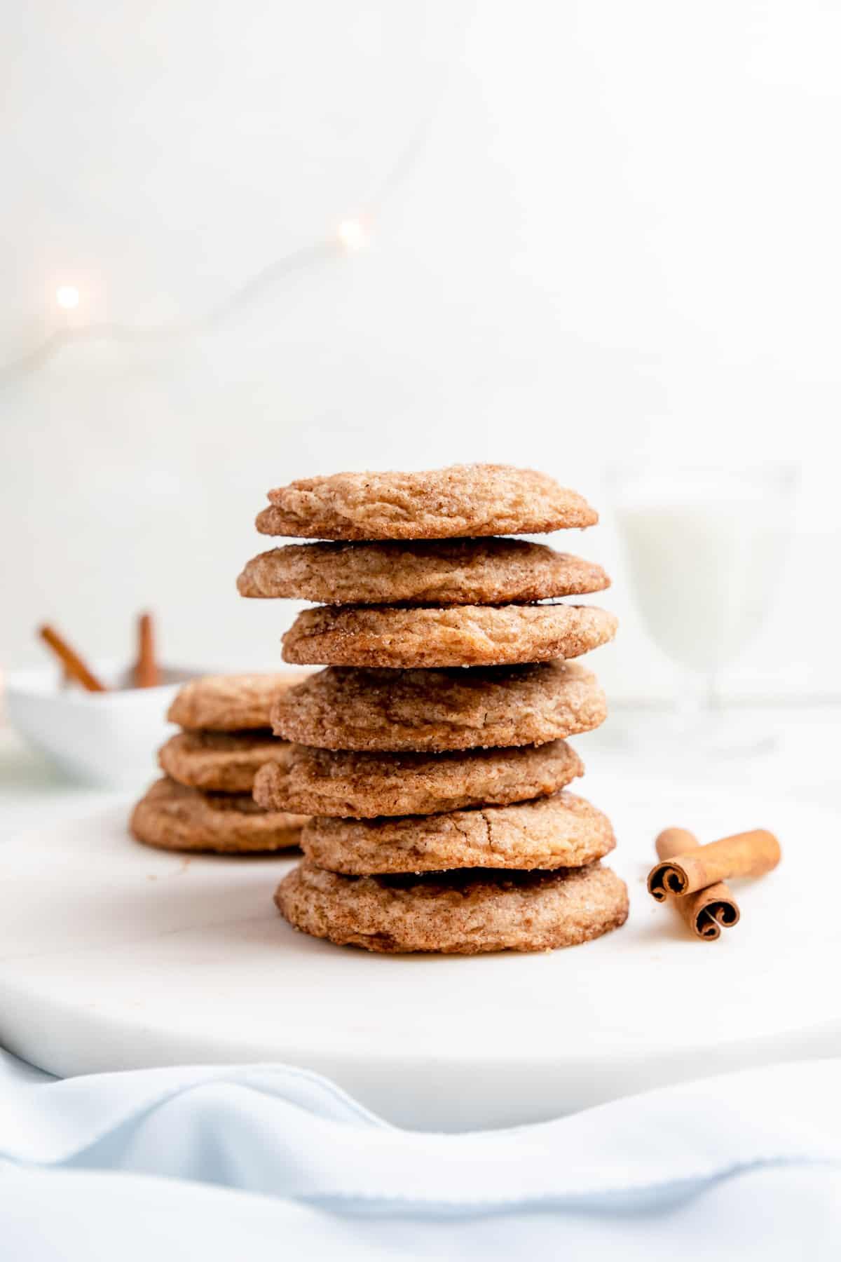 gluten free snickerdoodles stacked on top of each other