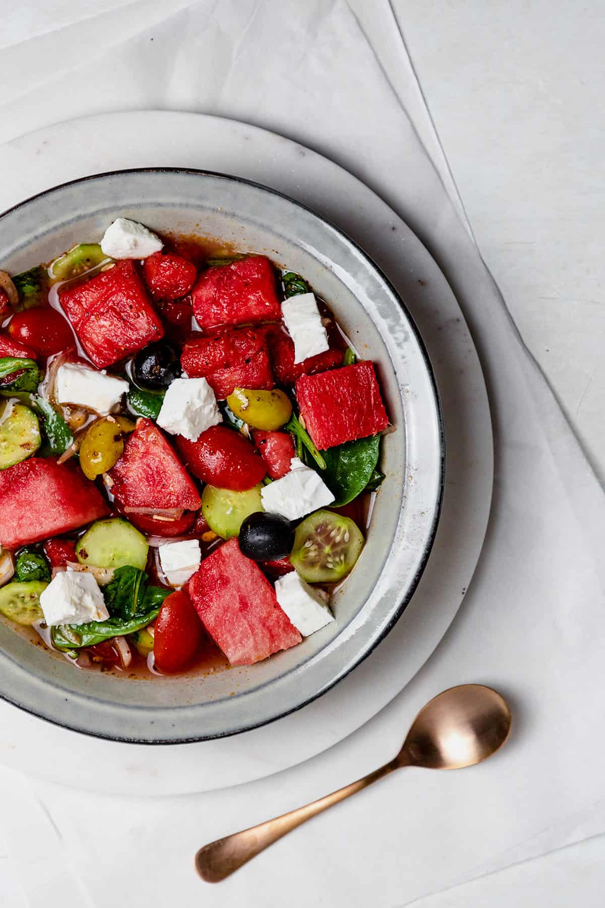 watermelon goat cheese salad in a gray bowl.
